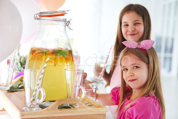 Kids by the candy bar with cake and citrus lemonade Stock photo © dashapetrenko