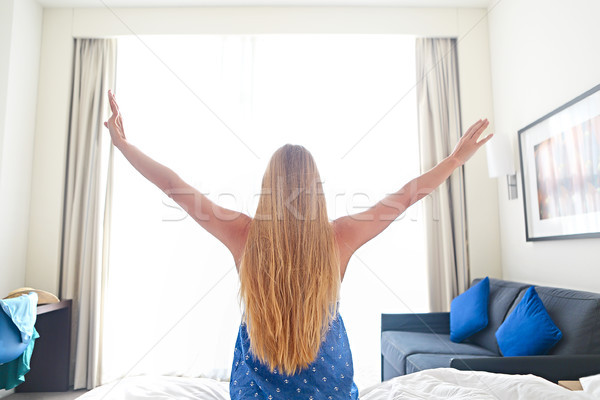 Woman stretching in bed after wake up Stock photo © dashapetrenko
