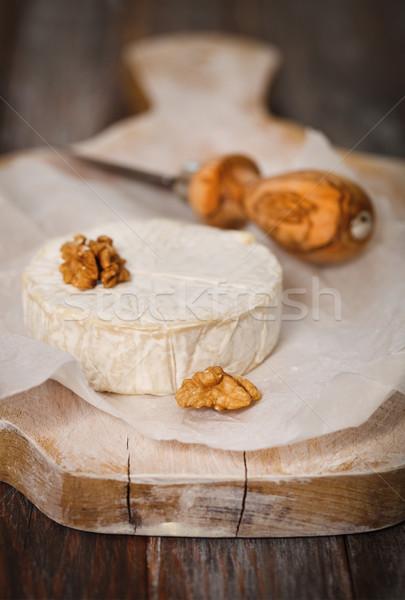 Cheese platter with nuts Stock photo © dashapetrenko
