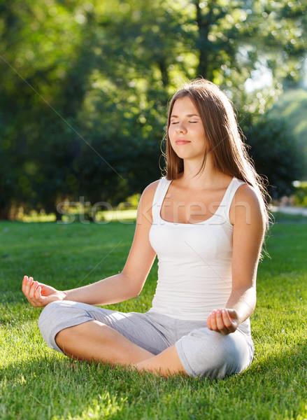 Attractive young woman doing yoga  Stock photo © dashapetrenko