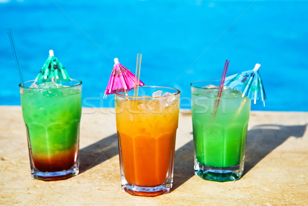 Cocotail drinks by tropical swimming pool Stock photo © dashapetrenko