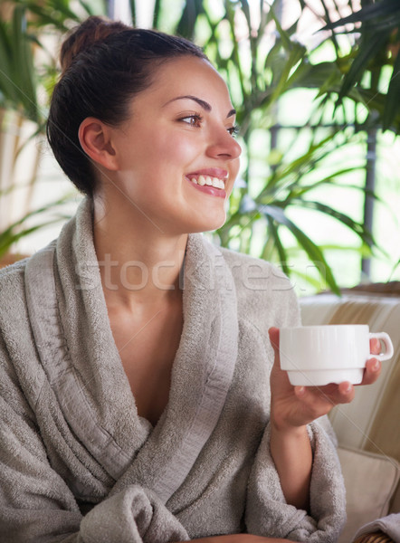 Young relaxed woman drinking tea at spa resort Stock photo © dashapetrenko