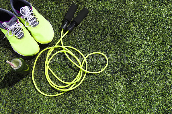 Running shoes, jump rope and drink bottle with green juice  Stock photo © dashapetrenko