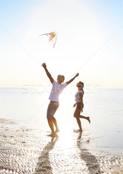 Feliz voador pipa praia férias na praia Foto stock © dashapetrenko