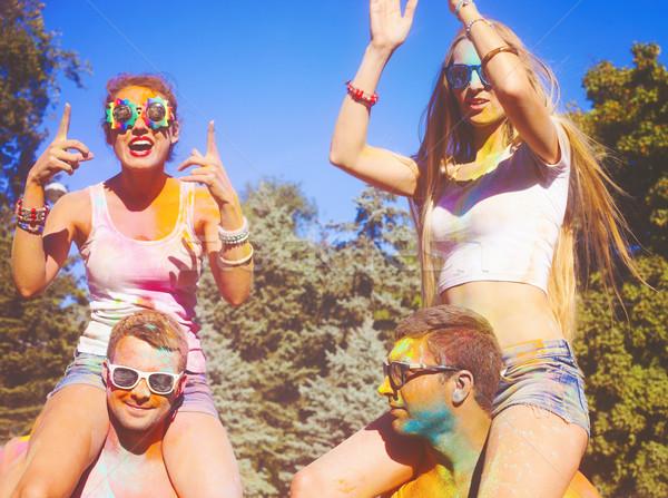 Happy friends on holi color festival Stock photo © dashapetrenko