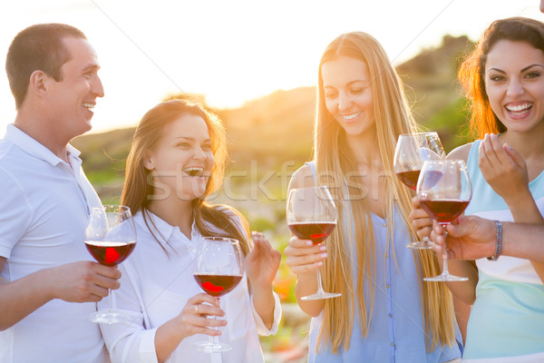 People holding glasses of red wine making a toast  Stock photo © dashapetrenko
