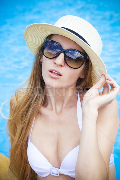 Pretty blond woman in a hat by a swimming pool Stock photo © dashapetrenko