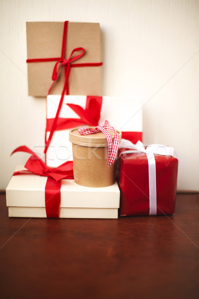 Handmade Christmas presents wrapped in paper with red and white  Stock photo © dashapetrenko