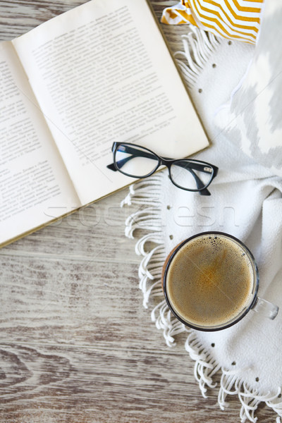 Cup of coffee staying by the book and glases on the wooden table Stock photo © dashapetrenko