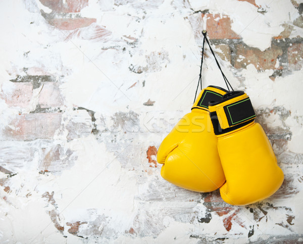 Pair of yellow boxing gloves hanging  Stock photo © dashapetrenko