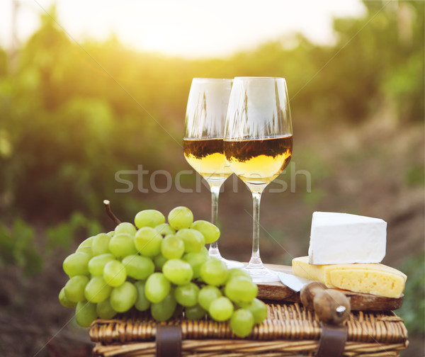 Various sorts of cheese, grapes and two glasses of white wine  Stock photo © dashapetrenko