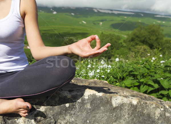 Attractive young woman doing a yoga pose for balance and stretch Stock photo © dashapetrenko
