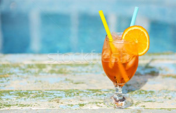 Glass of orange cocktail with slice of orange and straw Stock photo © dashapetrenko