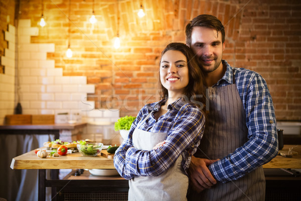 Young smiling couple cooking together  Stock photo © dashapetrenko