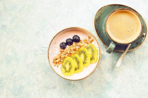 Copo granola iogurte fruto turquesa café Foto stock © dashapetrenko