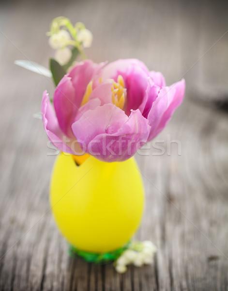 Húsvét tojás pasztell tulipán virág liliomok Stock fotó © dashapetrenko