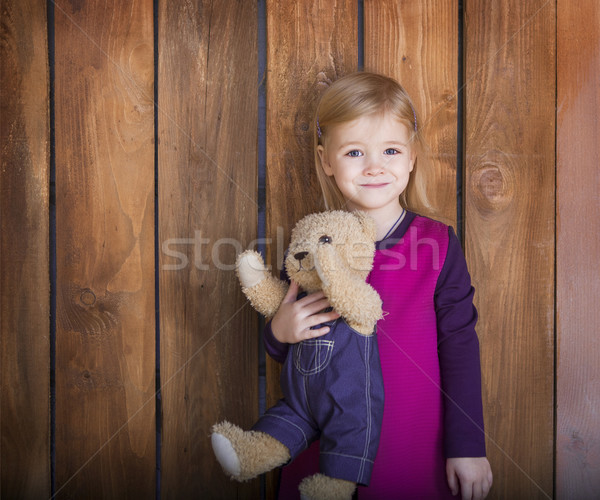 Portrait of the little smiling girl with toy bear Stock photo © dashapetrenko
