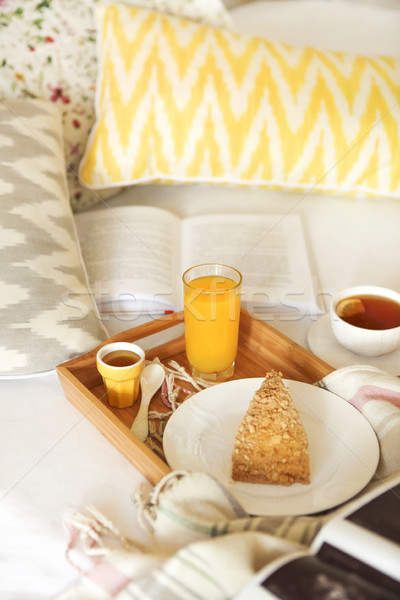 Cozy breakfast in bed with tea  Stock photo © dashapetrenko