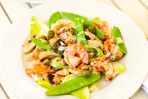 Salad with shrimps, mushrooms, capers with green peas Stock photo © dashapetrenko