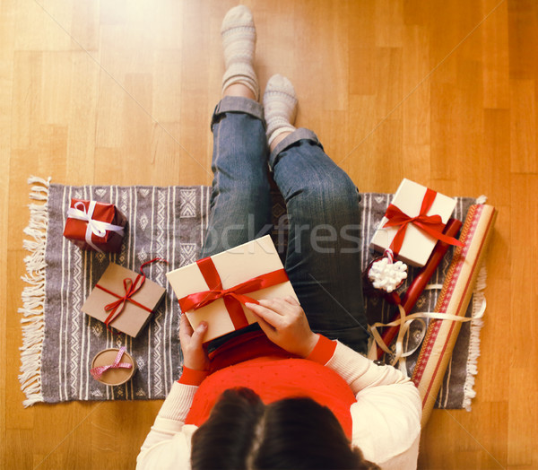 Young woman packing presents in Christmas time Stock photo © dashapetrenko