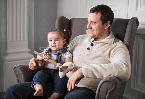 Boldog apa egyéves kislány bent baba Stock fotó © dashapetrenko