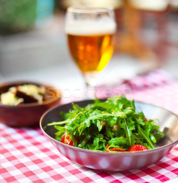 Egy üveg világos sör saláta kocsma étel Stock fotó © dashapetrenko
