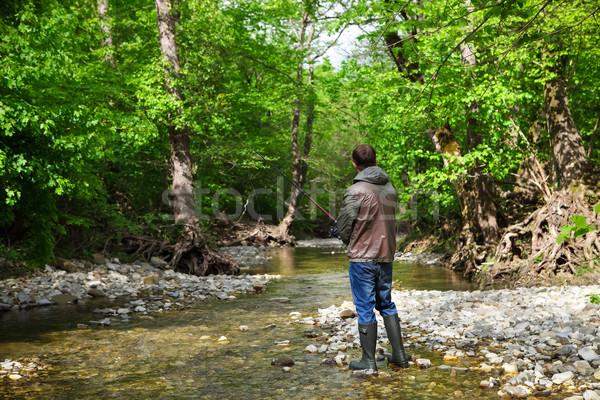 Pescador montana río primavera tiempo peces Foto stock © dashapetrenko