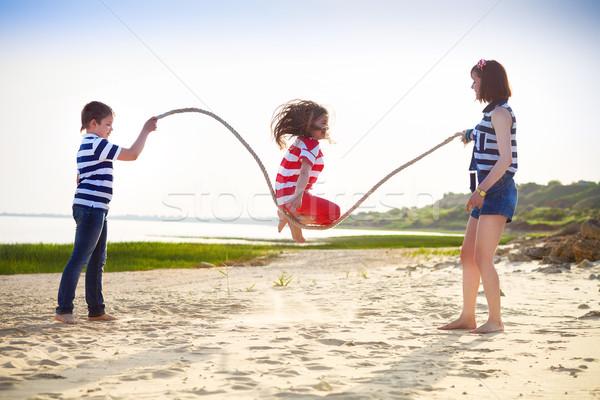 Stock fotó: Nyár · család · vakáció · lány · játszik · kötél