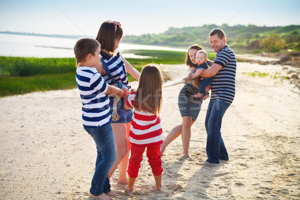 Guerra famiglia giocare spiaggia potere Foto d'archivio © dashapetrenko