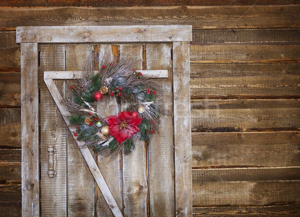 Christmas wreath on a rustic wooden door Stock photo © dashapetrenko
