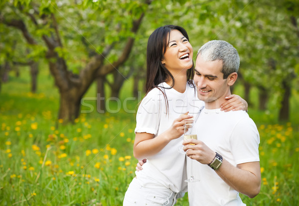Happy smiling couple in love in bloomy garden Stock photo © dashapetrenko