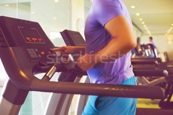 Egészséges fiatalember képzés futópad sport központ Stock fotó © dashapetrenko
