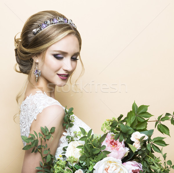 Young pretty bride with wedding bouquet Stock photo © dashapetrenko