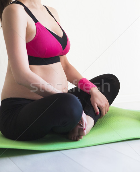 One young pregnant woman sitting on floor Stock photo © dashapetrenko