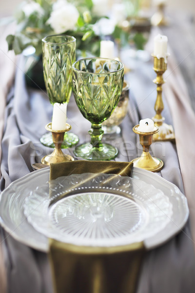 Festive table decorated with candles and covered with a tableclo Stock photo © dashapetrenko