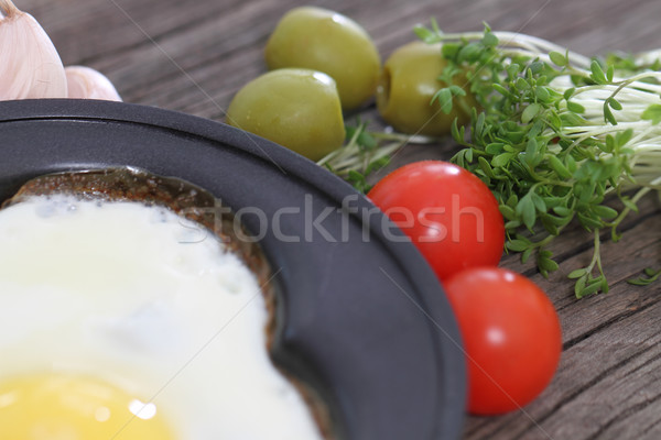 Fried egg with vegetables Stock photo © dashapetrenko