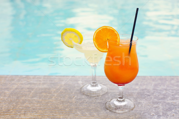 Glasses of tropical cocktail on poolside Stock photo © dashapetrenko