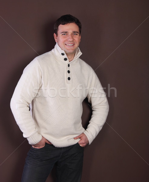 Handsome man leaning against the wall Stock photo © dashapetrenko
