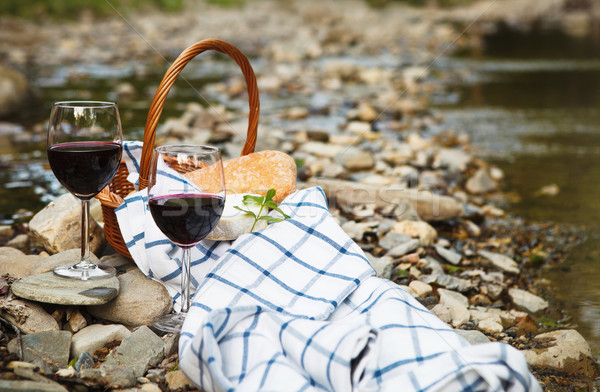 Red wine, cheese and bread served at a picnic Stock photo © dashapetrenko