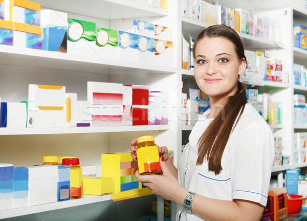 Pharmacist holding out tablets in bottle at drugstore Stock photo © dashapetrenko