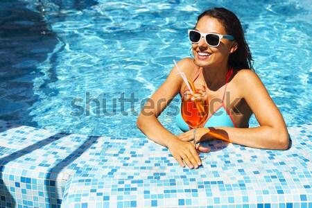 Gorgeous blonde woman in a yellow bikini in the water  Stock photo © dashapetrenko
