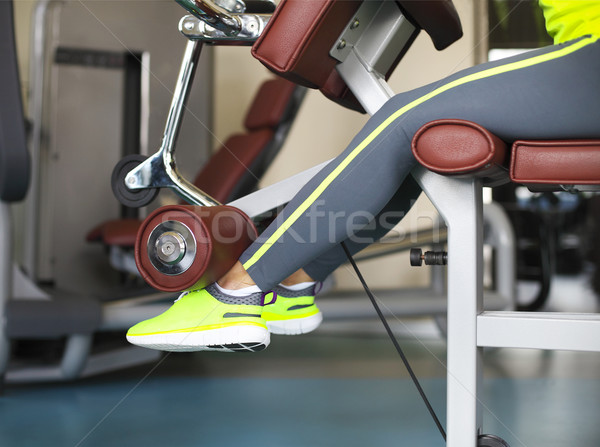 Young sporty women doing exercises in the gym centre Stock photo © dashapetrenko