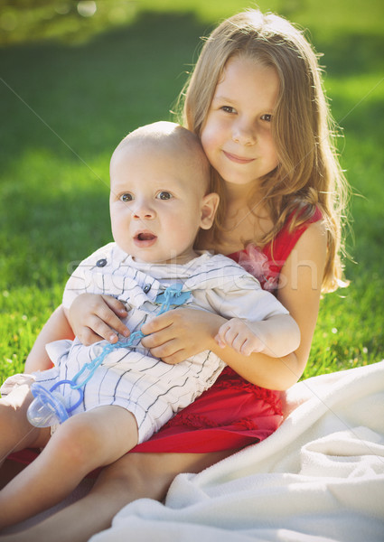 Two children baby brother and sister on green meadow Stock photo © dashapetrenko