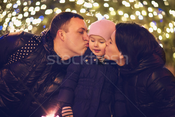 Family with Bengal light outside over Christmas background Stock photo © dashapetrenko