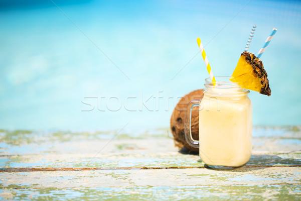Exotic pineapple cocktail near pool. Pina colada Stock photo © dashapetrenko