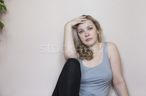 Portrait of middle age woman in the room Stock photo © dashapetrenko