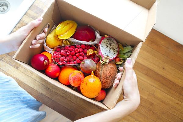 Fiatal nő tart doboz gyümölcsök zöldségek otthon Stock fotó © dashapetrenko