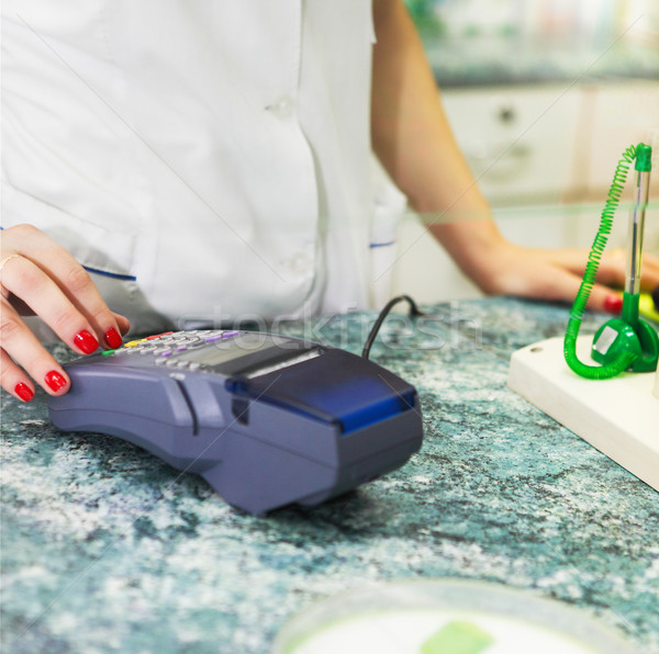 Close up of human hand over payment machine in drug store Stock photo © dashapetrenko
