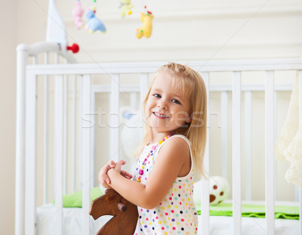 Little cute girl in nursery room  Stock photo © dashapetrenko