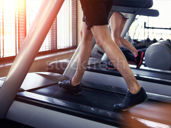 Egészséges férfi nő fut futópad tornaterem Stock fotó © dashapetrenko